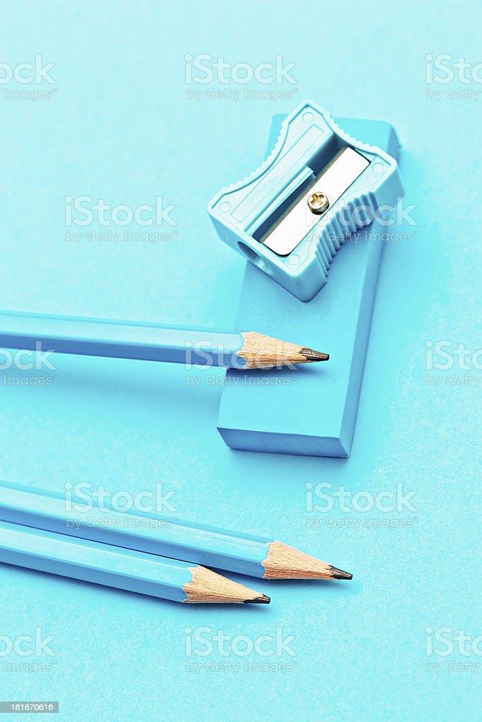 \'Three blue pencils, a blue eraser and a blue pencil sharpener, all...