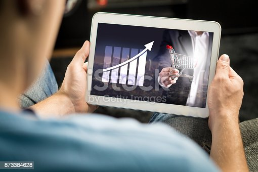 istock Statistics, analytics and financial report on tablet screen. Success and growth concept. 873384628