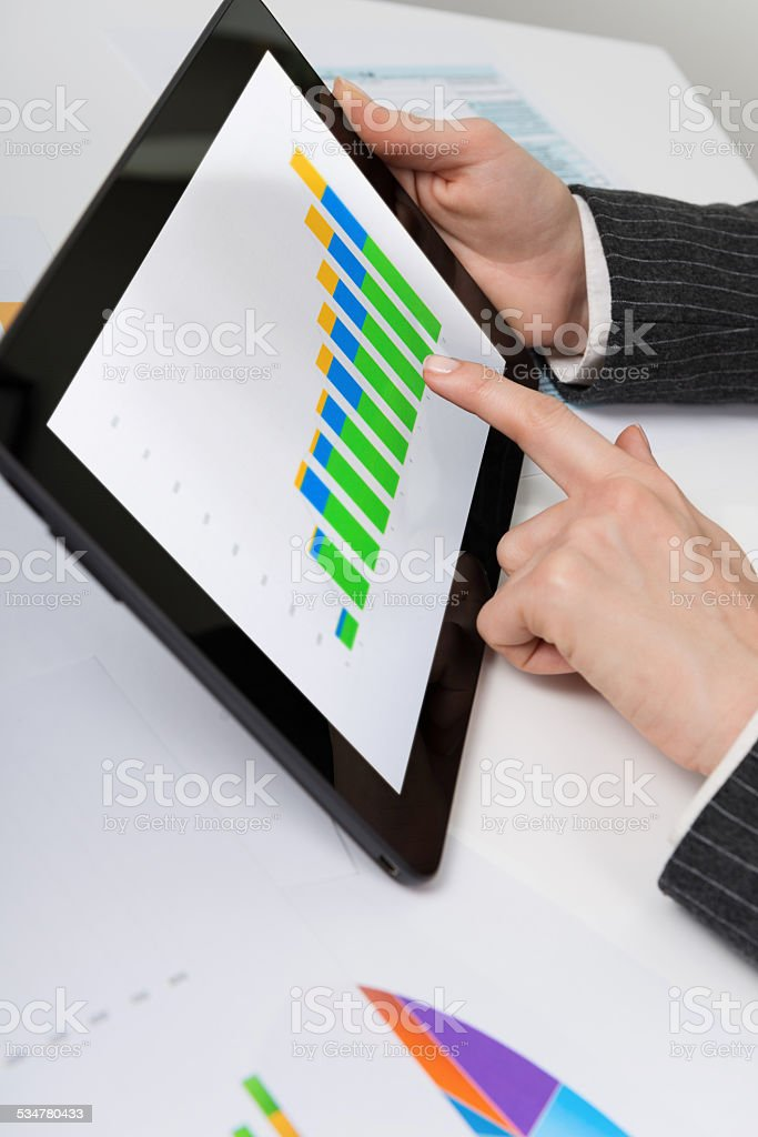 Statistics on economic growth on online news on digital tablet stock photo