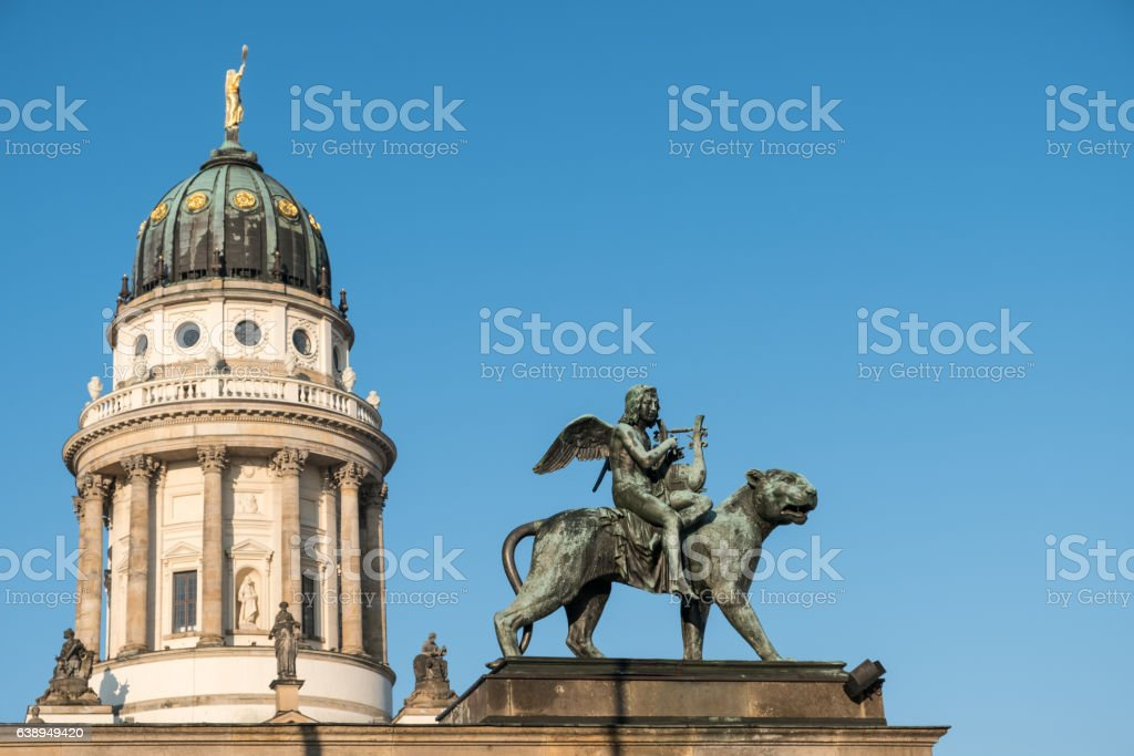 Statue and french dome at Gendarmenmarkt, historic Berlin stock photo
