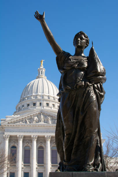 Statue and State Capital Statue with Wisconsin State Capital building in background.  Madison, Wisconsin, USA. wisconsin state capitol stock pictures, royalty-free photos & images