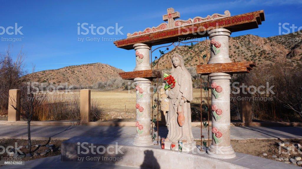 Statue at El Santuario de Chimayo in Chimayo in New Mexico stock photo