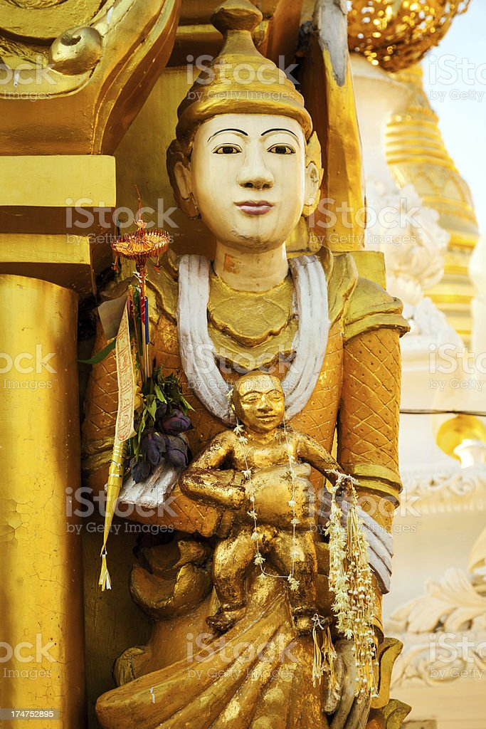 Statue at Shwedagon Pagoda, Myanmar royalty-free stock photo