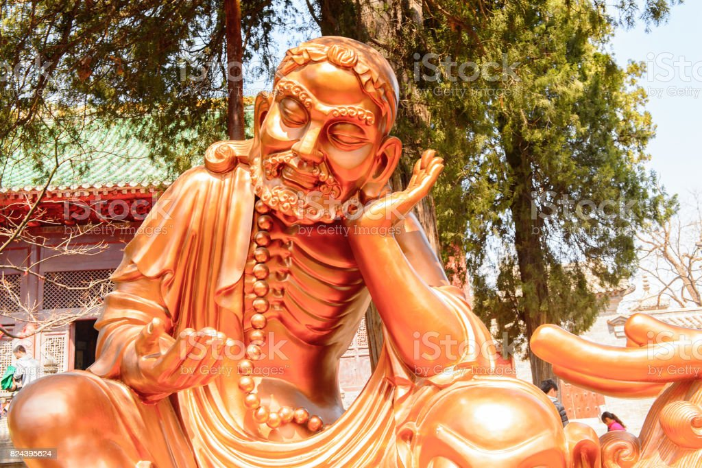Statue at the Authentic Shaolin Monastery (Shaolin Temple), a Zen Buddhist temple. UNESCO World Heritage site stock photo