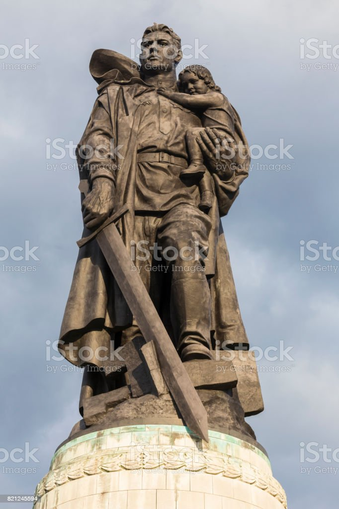statue at the russian war memorial in treptow berlin germany stock photo