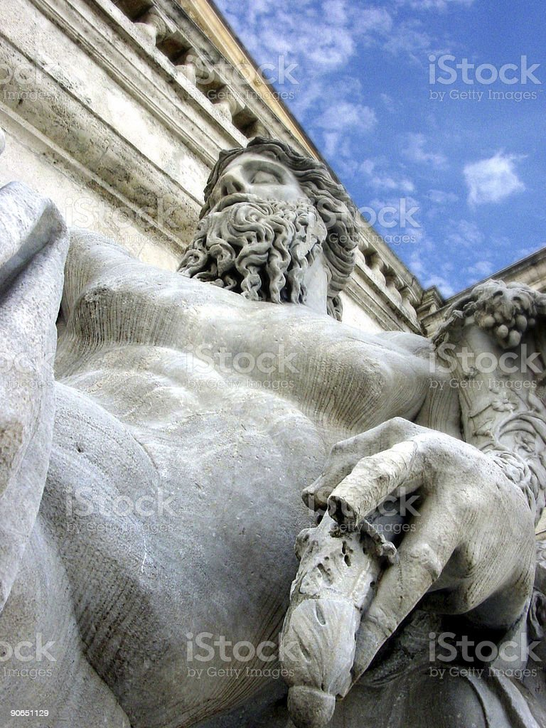 Statue below blue sky. royalty-free stock photo