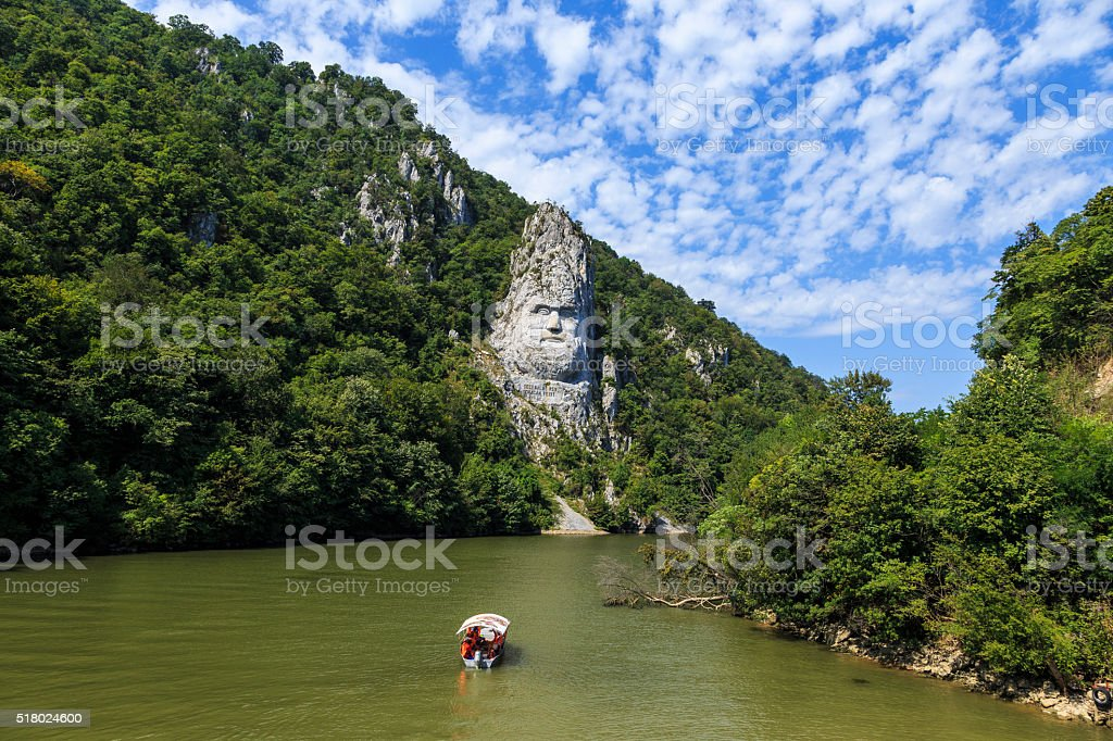 Statue carved in stone over river stock photo