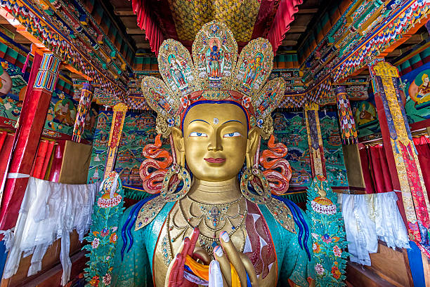 Statue depicting Maitreya at the Thiksey Monastery Thikse, India - August 16, 2015: View of the huge statue depicting Maitreya in Thikse Monastery. Maitreya is regarded as a future Buddha of this world in Buddhist eschatology bodhisattva stock pictures, royalty-free photos & images