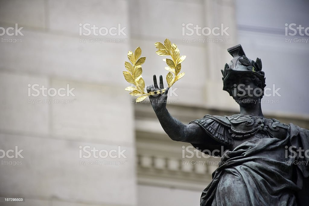 Statue holding a golden laurel  stock photo