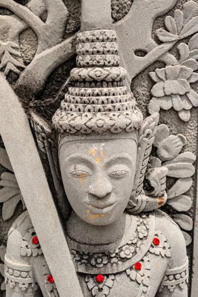 Statue in a Buddhist temple stock photo