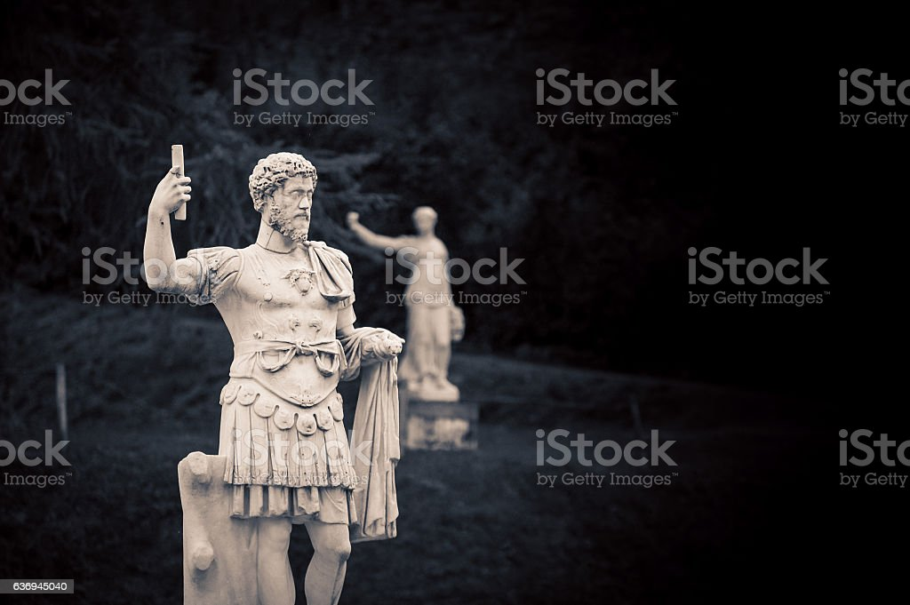 statue in a park in florence stock photo