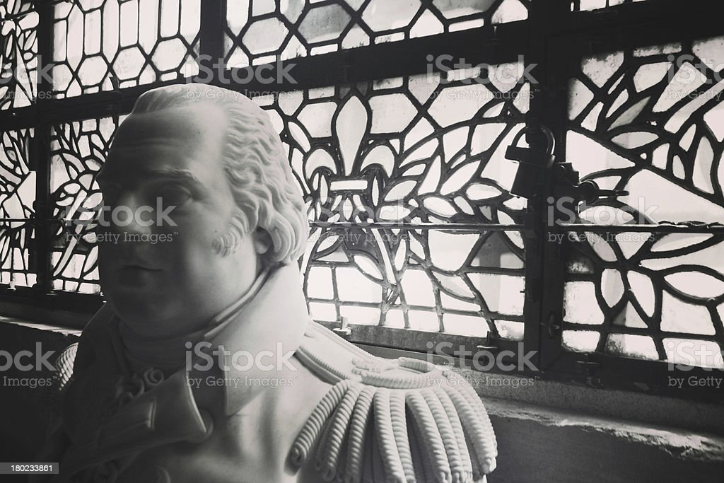 Statue in front of stained glass windows, France stock photo