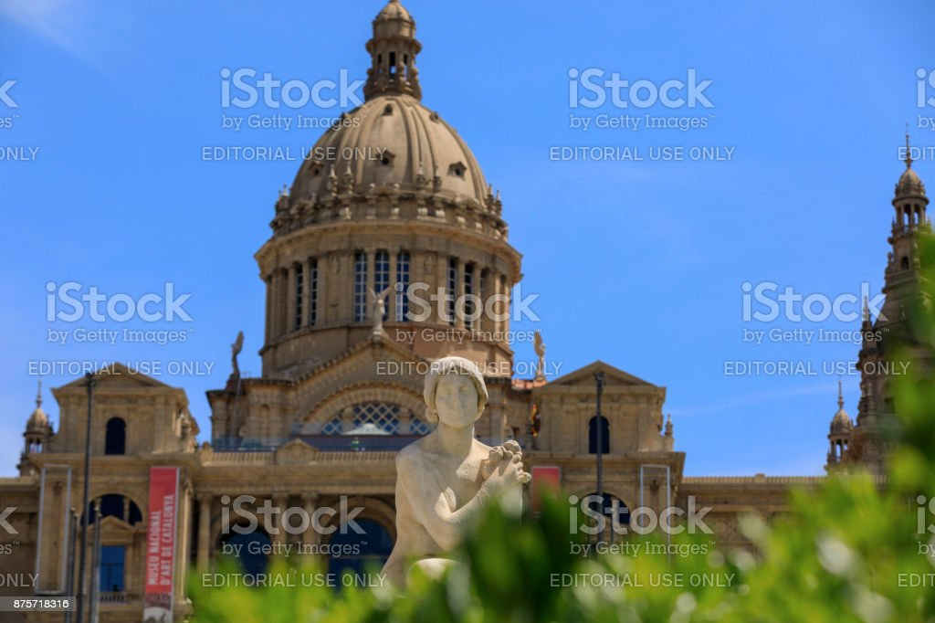 statue in front of the National Palace at Barcelona stock photo