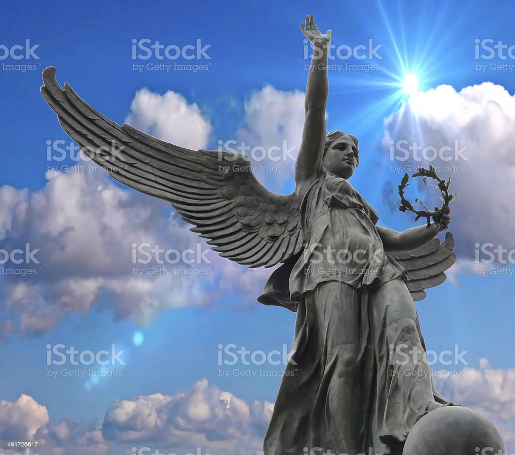 Statue in the blue sky. stock photo
