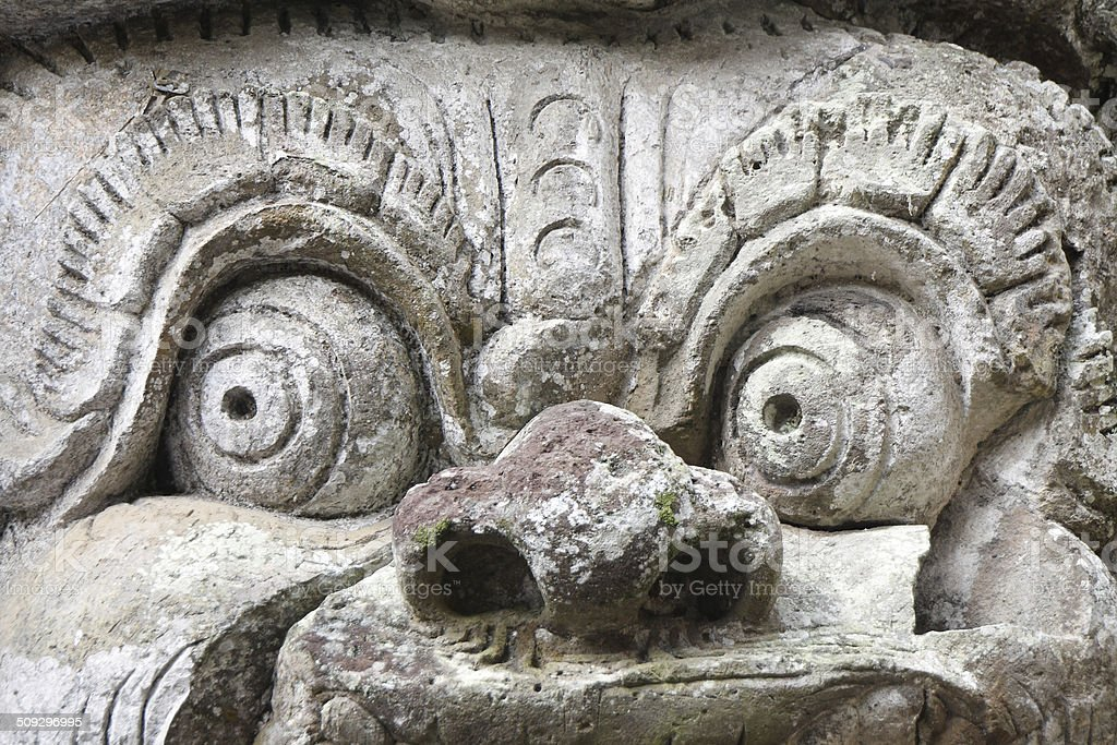 Statue in the entrance of Goa Gajah stock photo