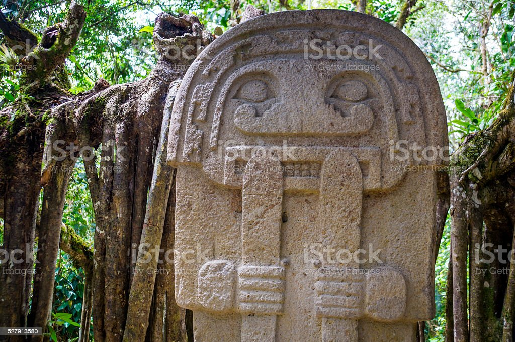 Statue in the rainforest - San Agustin, Colombia stock photo