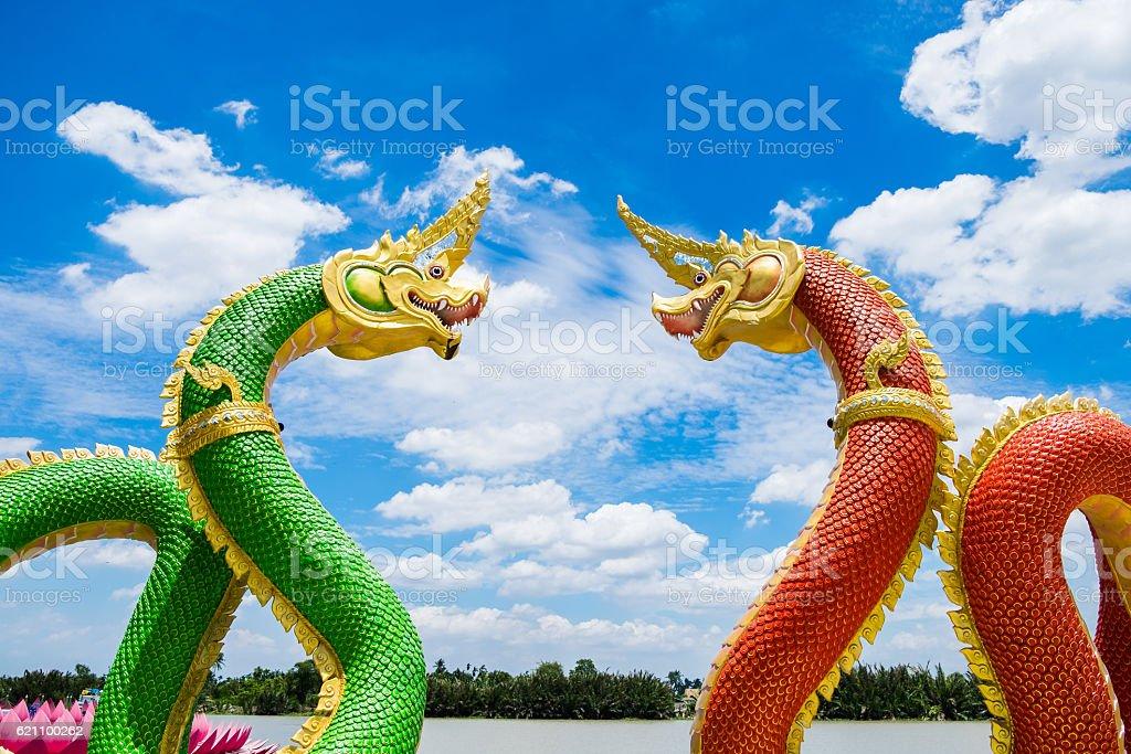 Statue naga mythology green red facing curve and blue sky stock photo