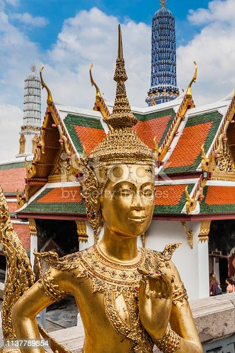 Statue of a kinnara (mythological creature, half bird, half man) in Wat Phra Kaew (The Temple of Emerald Buddha), The Grand Palace, Bangkok (Thailand).