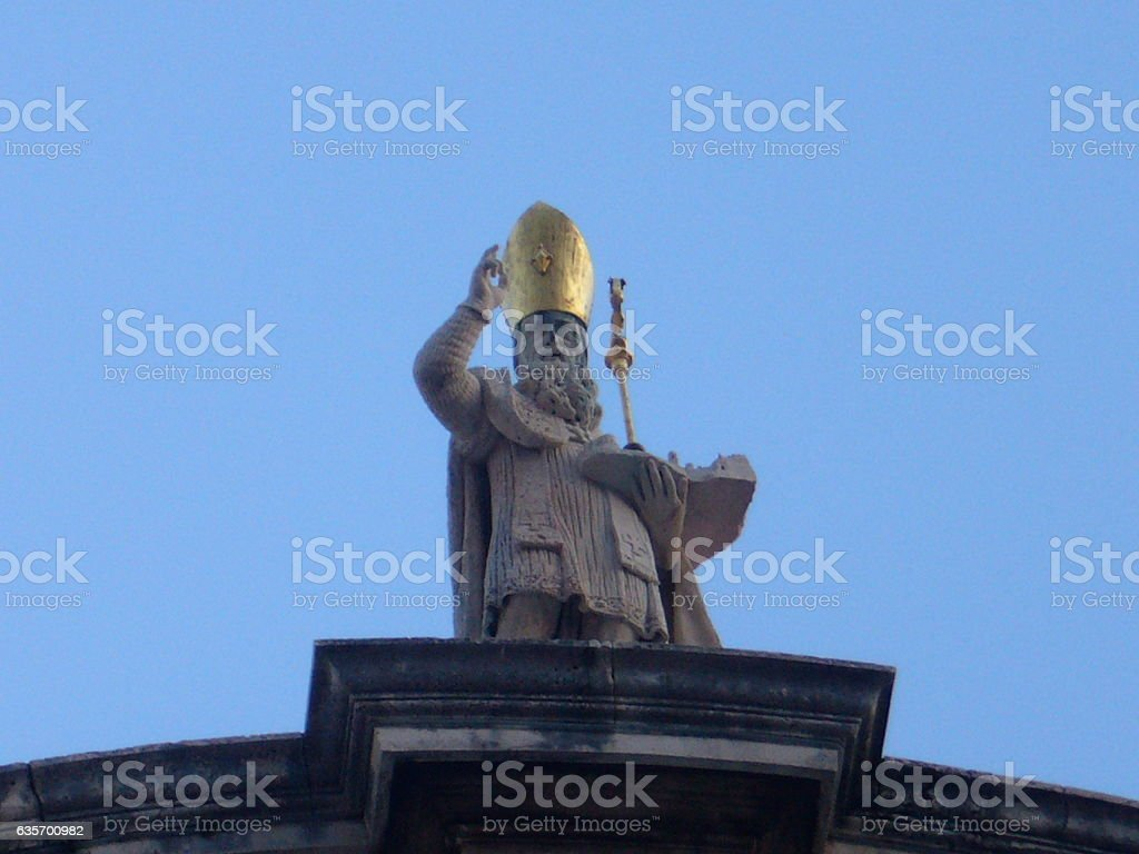Statue of a priest with a golden hat royalty-free stock photo