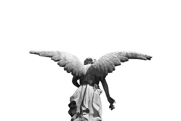 Statue of a winged angel photographed from behind stock photo