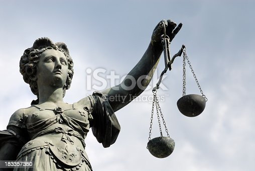 istock Statue of a woman holding a balance scale 183357380