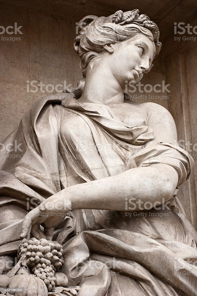 Statue of a Woman with Grapes at Trevi Fountain stock photo