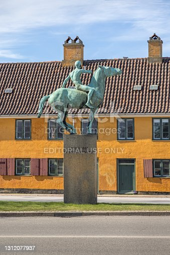 istock Statue of a young naked man on horseback 1312077937