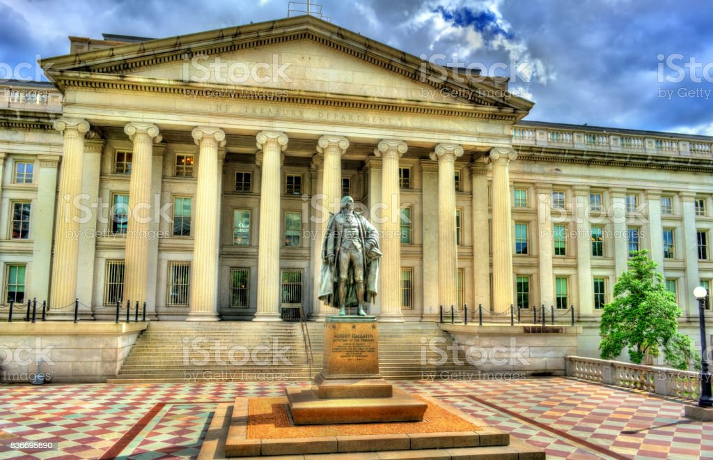 Statue of Albert Gallatin in front of US Treasury Department building in Washington, DC stock photo
