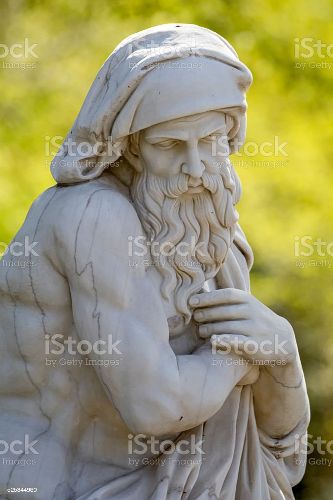 Statue of an old wise man stock photo