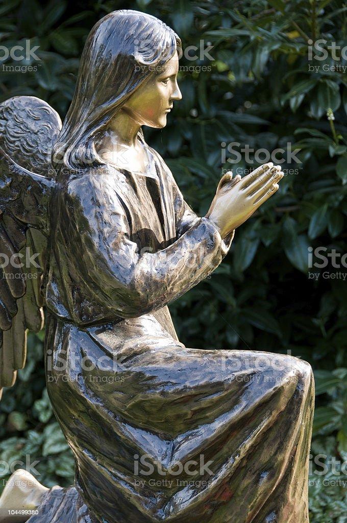 Statue of angel at prayer stock photo
