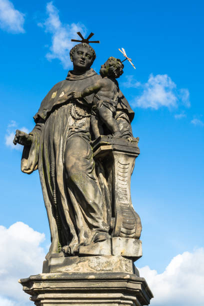 statue of anthony of padua on charles bridge in prague - st. anthony of padua stock photos and pictures