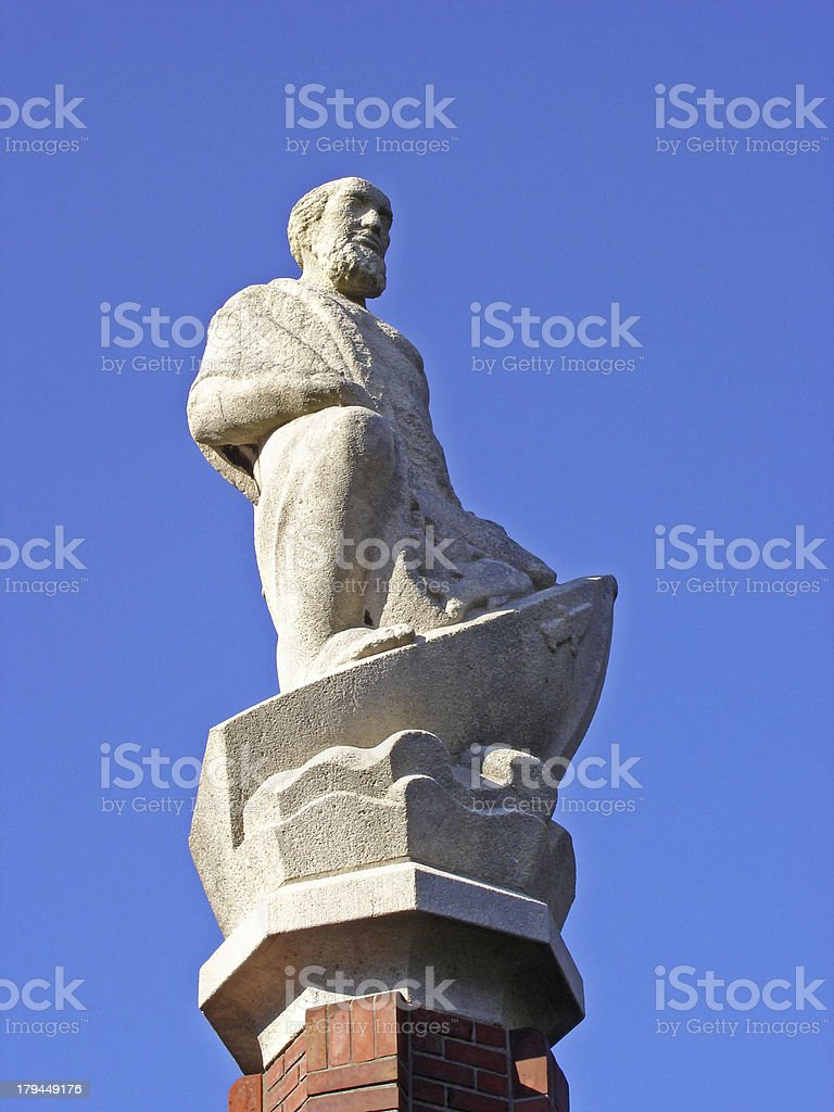Statue of Apostle Nathaniel isolated in blue stock photo