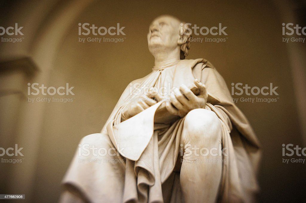 Statue of Brunelleschi sitting and thinking stock photo