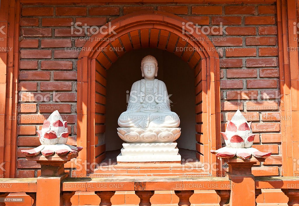 Statue of Buddha Amitabha in Tran Quoc Pagoda. Hanoi, Vietnam stock photo