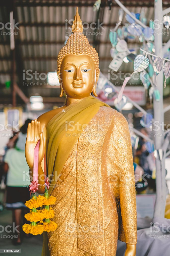 Statue of Buddha gold Thailand stock photo