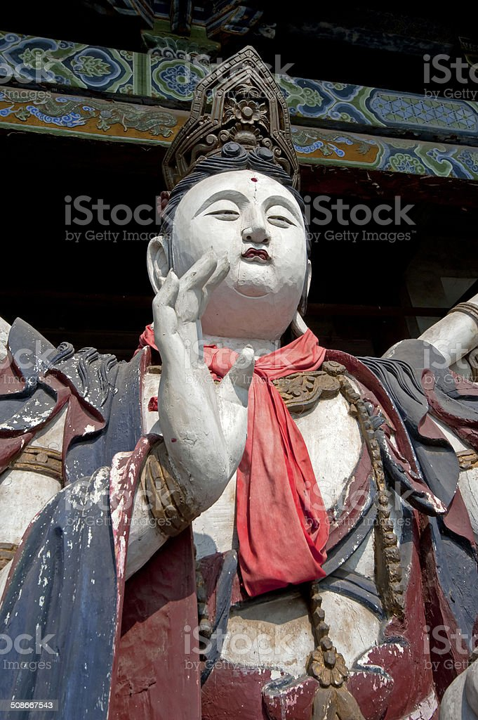 Statue of Buddhist deity in Chinese temple stock photo