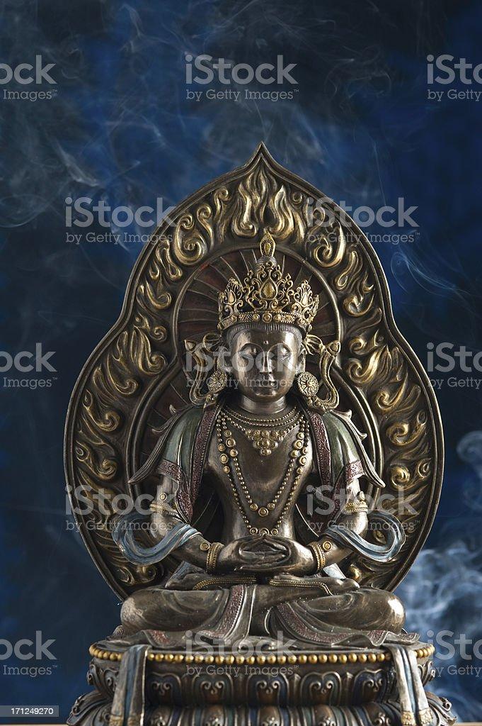 Statue of Budhha on blue background royalty-free stock photo