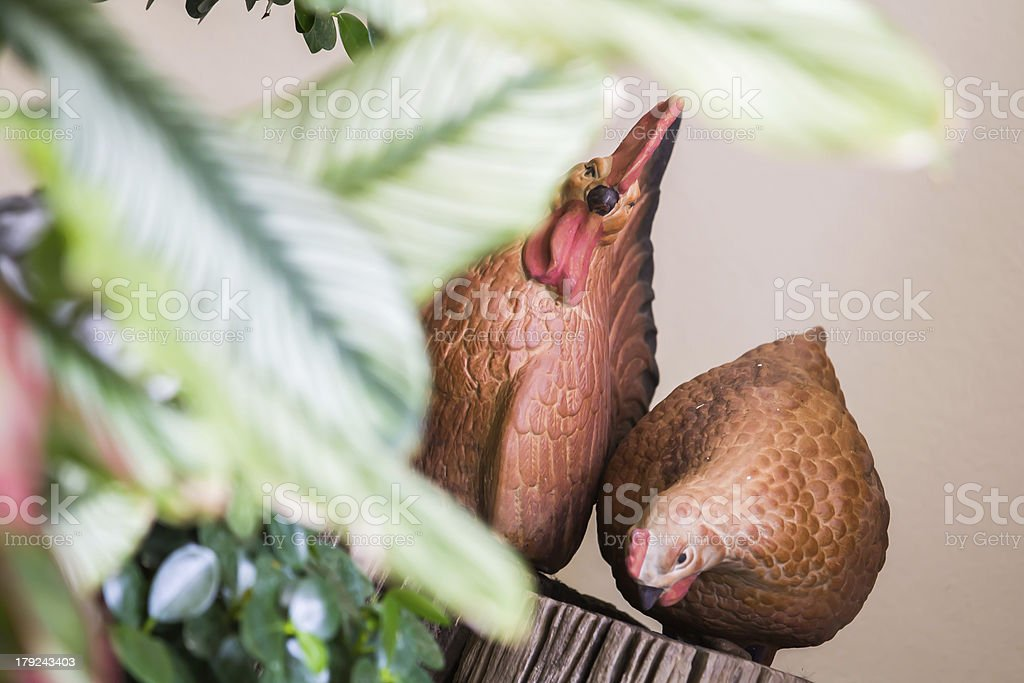 Statue of chickens in the garden. royalty-free stock photo