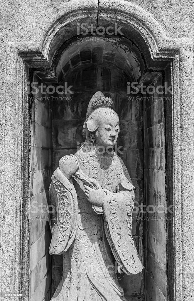 Statue of Chinese woman in Thai Temple royalty-free stock photo