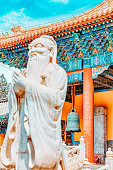 istock Statue of Confucius, the great Chinese philosopher in Temple of Confucius at Beijing.Focus on the background. 1220339856