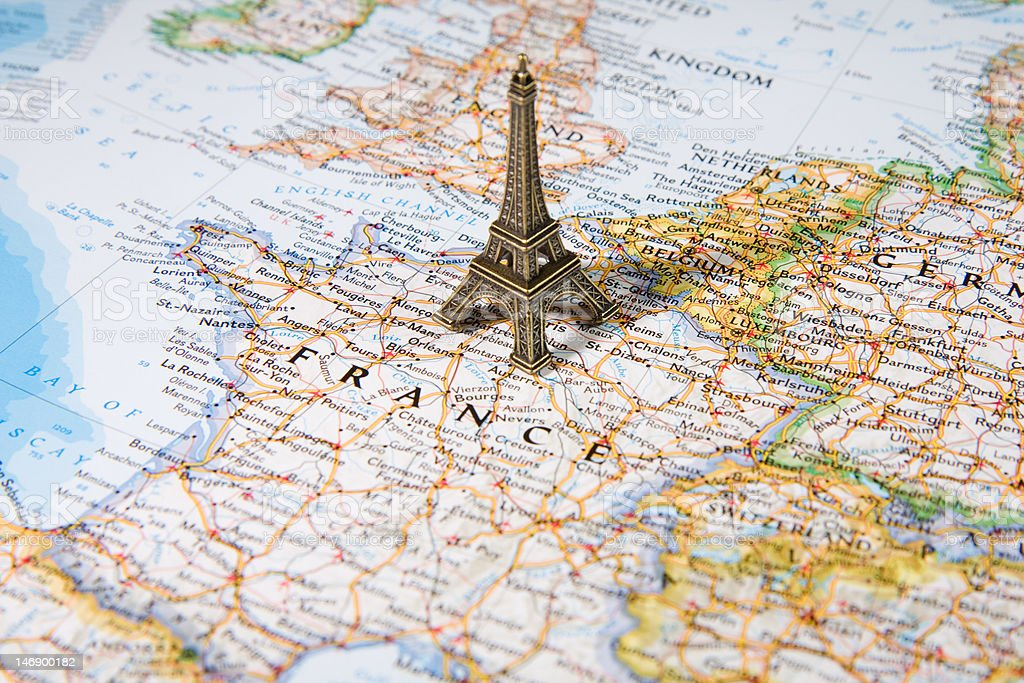Statue of Eiffel Tower on a map, most beautiful destination stock photo