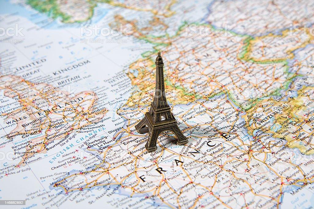 Statue Of Eiffel Tower On A Map Travel Destination Paris Stock Photo