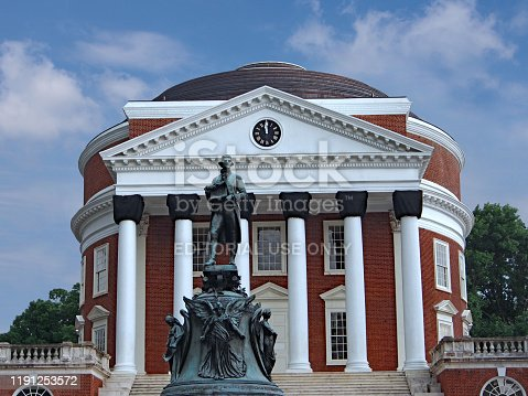 Charlottesville, Virginia, USA - June 11, 2014: Statue of the university's founder Thomas Jefferson in front of the University of Virginia Rotunda, by sculptor Ezekial Moses (died 1917), has become controversial as Jefferson was a slave owner.