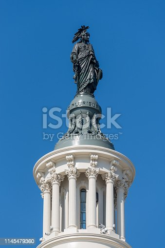 Statue of Freedom on the dome of the US Capitol Building in Washington DC, capital city of the United States