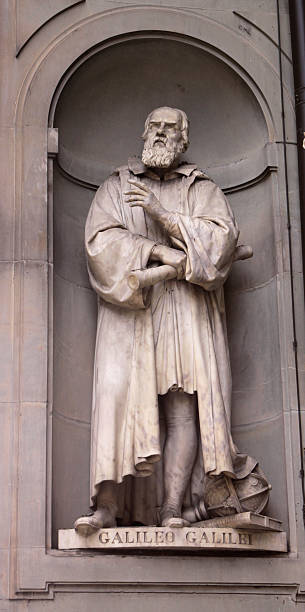 Statue of Galileo A statue Galileo Galilei sitting outside of the Uffizi, in Florence, Italy.  Galileo is a famous astronomer. galileo galilei stock pictures, royalty-free photos & images