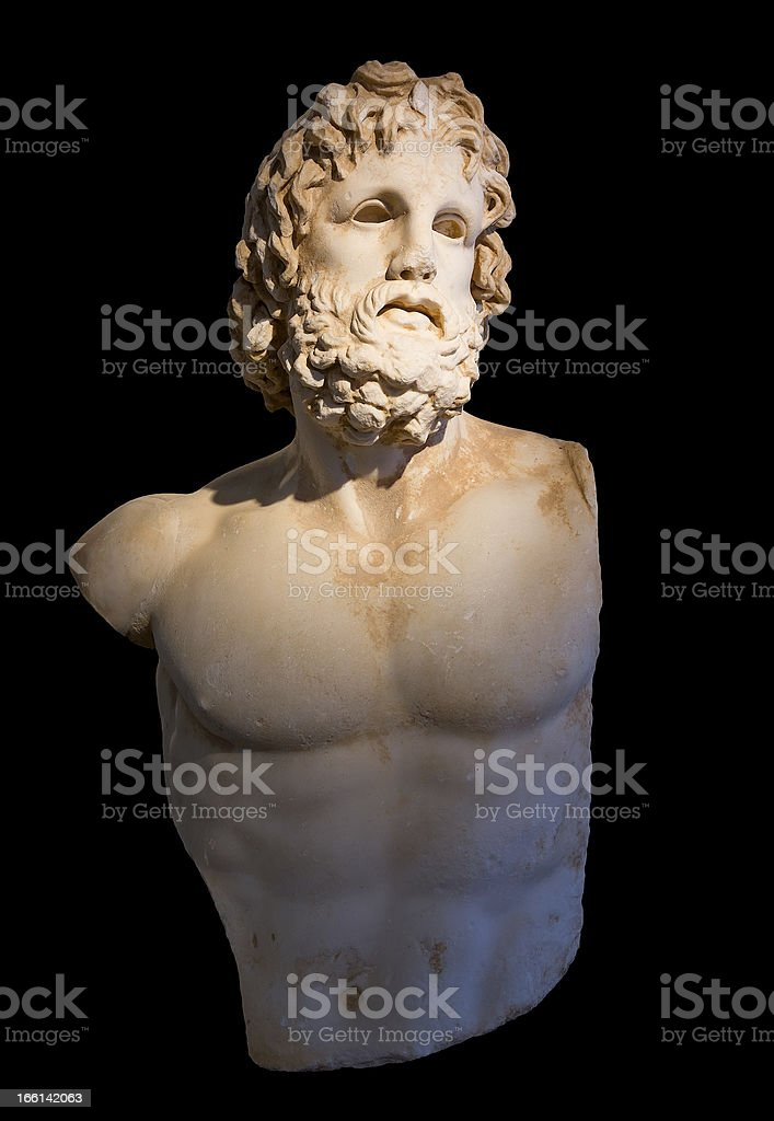 Statue of god Asclepius with selective lighting, black background royalty-free stock photo