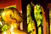 Statue of buddha yoga meditating for soul mind body spirit wellness and state of mind calmness in the temple complex of asian royal palace in Chiang Mai Thailand