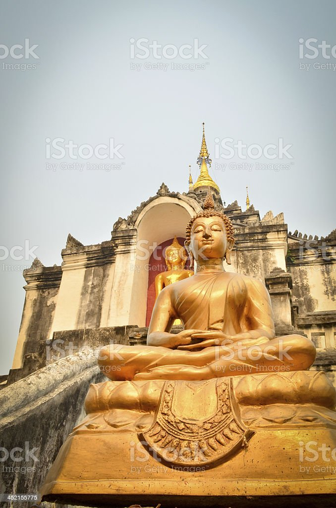 Statue of golden ancient Buddha in Temple THAILAND royalty-free stock photo