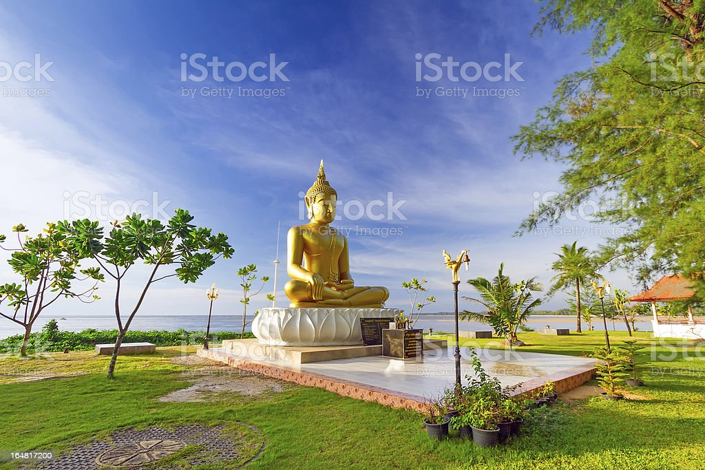 Statue of golden Buddha at the sea stock photo