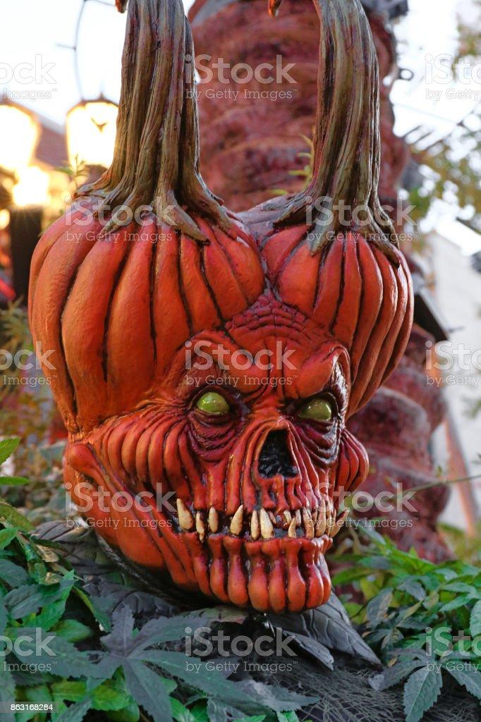 Statue of Halloween pumpkins. Scary Jack O' Lantern. stock photo